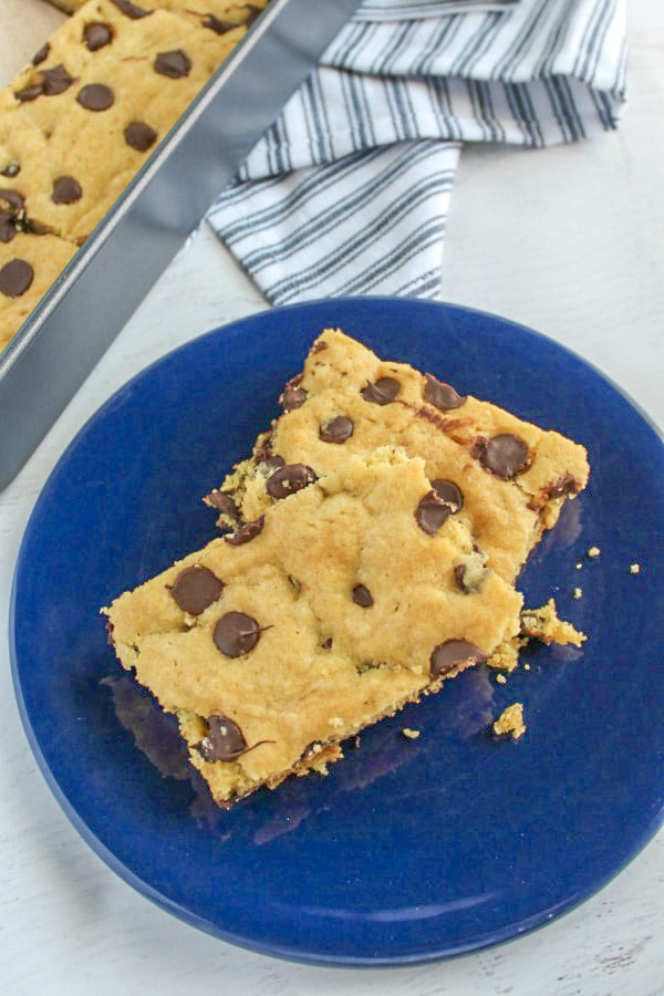 Two cookie bars on a small blue plate on white marble background