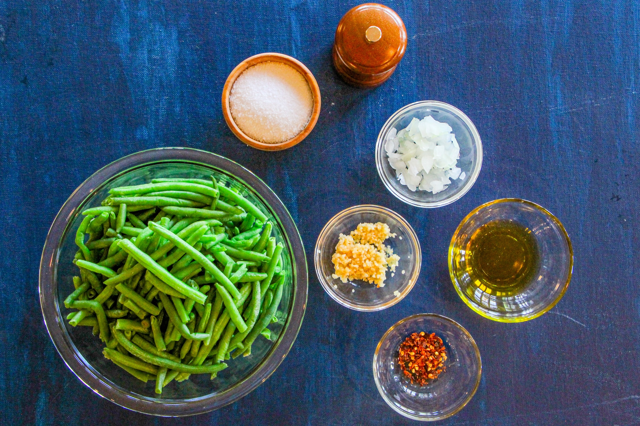 Uncooked green beans and ingredients to make recipe