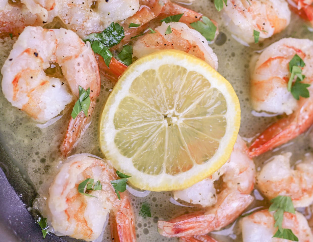 Garlic Butter Shrimp cooked in a skillet