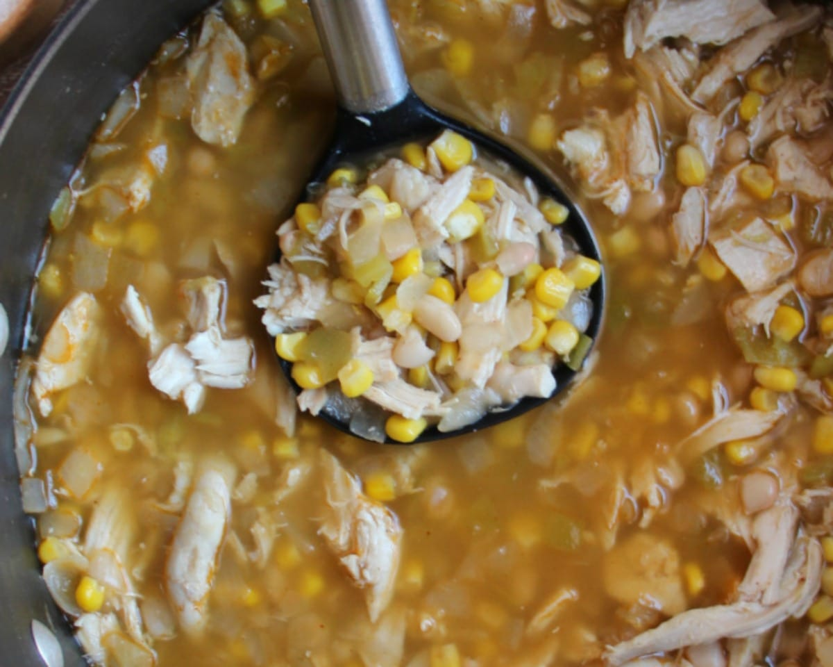 Easy White Chicken Chili in a large pot with a ladle.
