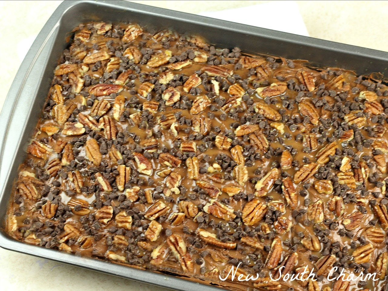 if you like Turtle Candy you will love this easy to make recipe for Chocolate Turtle Poke Cake.