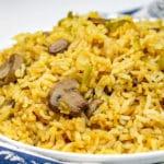 Prepared mushroom fried rice on white plate