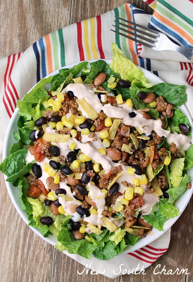 Loaded Taco Salad with Chipotle Lime Sauce is loaded with all your favorite taco flavors but in a healthy salad!