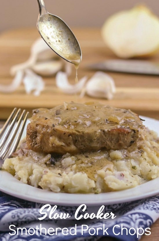 Slow Cooker Smothered Pork Chops are pure Southern comfort food. The pork chops are juicy and fork tender. Plus, they are smothered in a delicious and savory onion and garlic gravy.