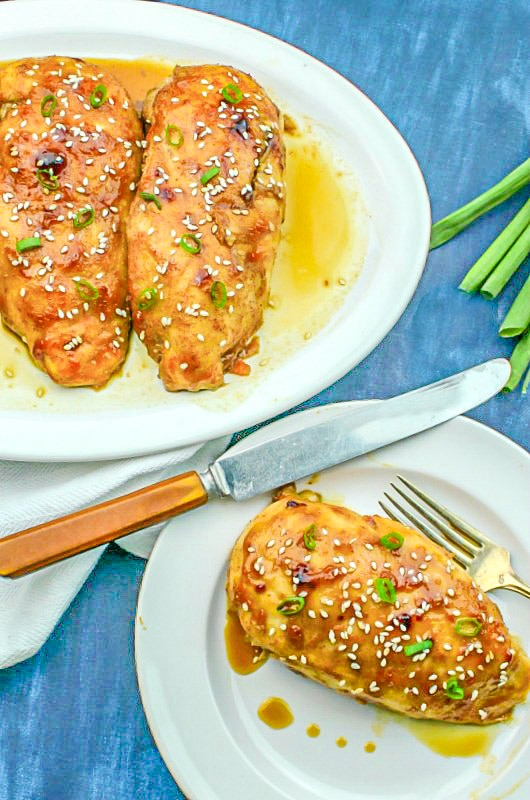 Honey Garlic Chicken on a white plate with knife
