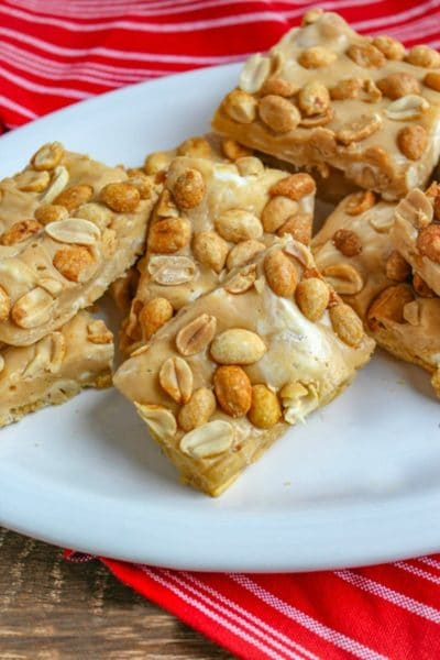 Salted Peanut Roll Bars cut into rectangles and displayed on white platter
