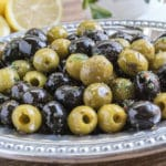 mixture of green and black marinated olives on a platter