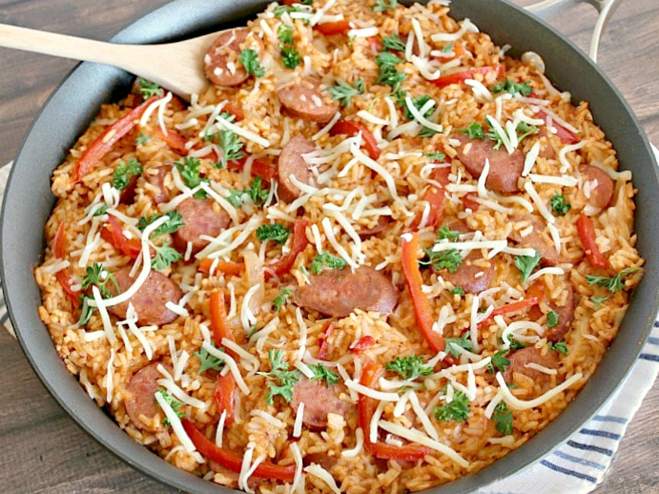Easy Smoked Sausage and Rice Skillet is an easy, family loved, main dish packed with tons of  flavor that is ready in just 30 minutes. It's the perfect weeknight meal when need to get dinner on the table fast.