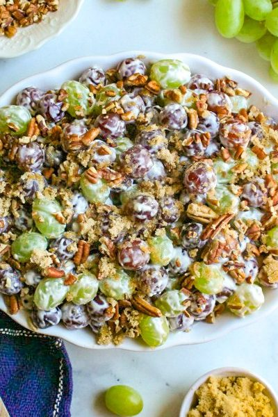 Grape Salad topped with pecan and brown sugar.