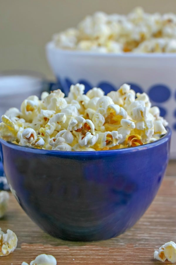 Stovetop Popcorn in individual sized blue bowl.