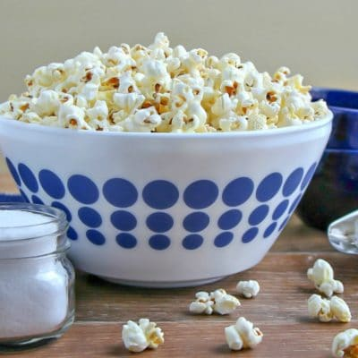 Stovetop Popcorn in a piled high is a white bowl with blue polka dots.