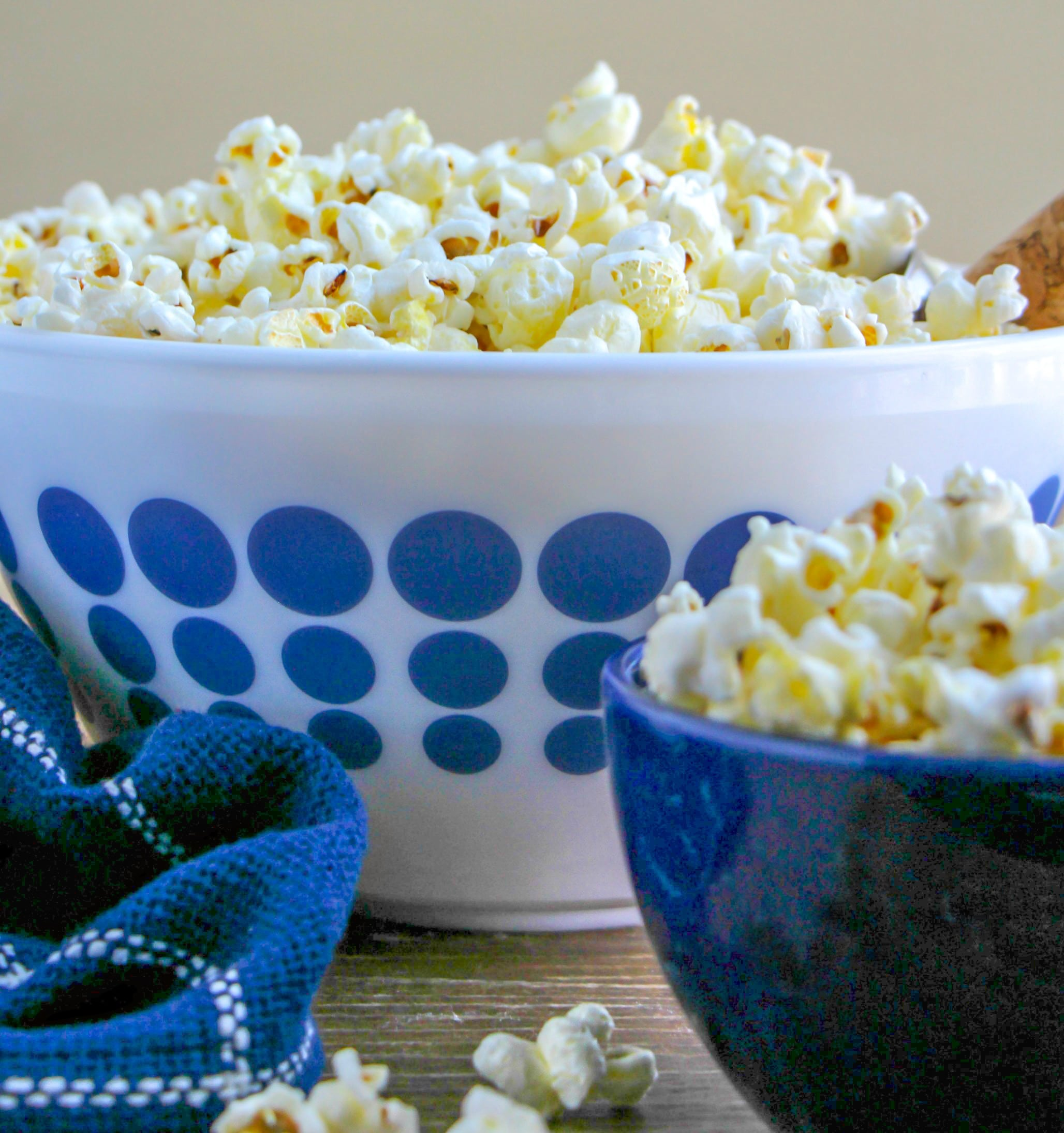 Close of photo a homemade popcorn in blue and white bowls.