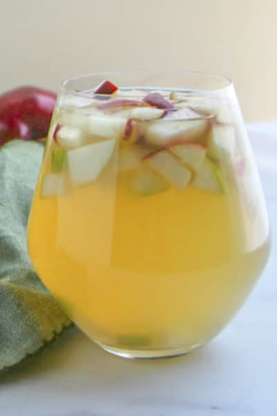 Apple and Pear Sangria in a stemless wine glass