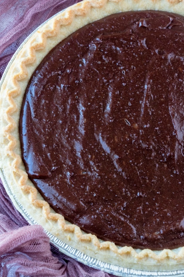 Close up of Old Fashioned Chocolate Pie accented with pink napkin.
