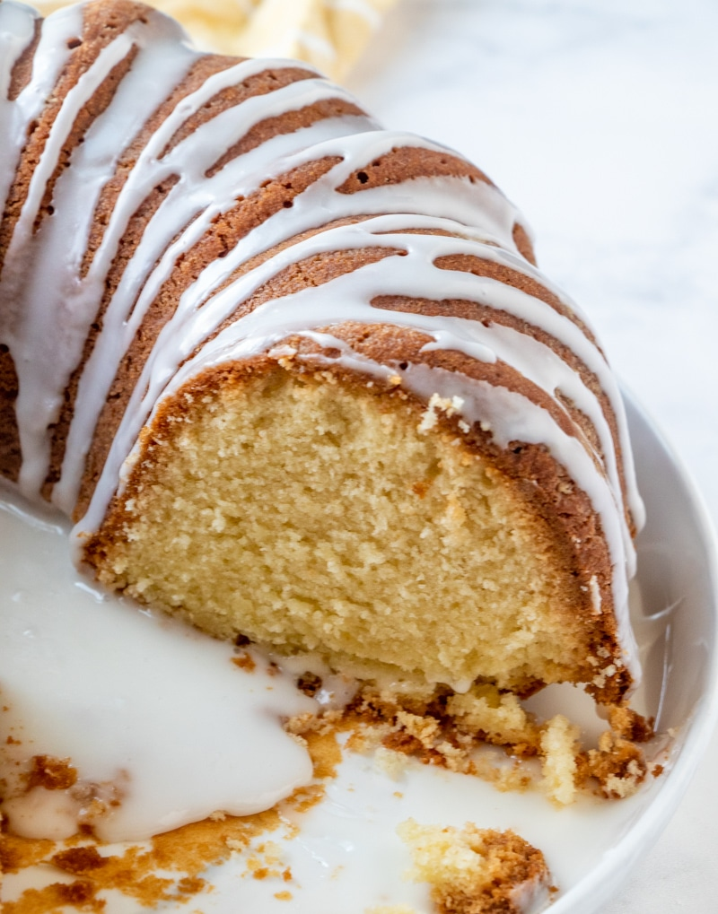 7 Up Bundt Cake with glaze sliced showing the moist yellow cake inside
