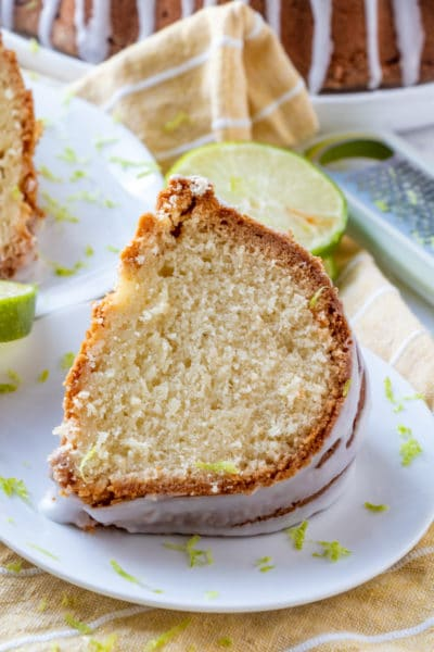 7 Up Cake slice on plate garnished with lime zest.