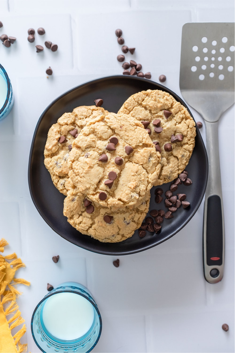 Chocolate Chip Cookies on black plate with spatula