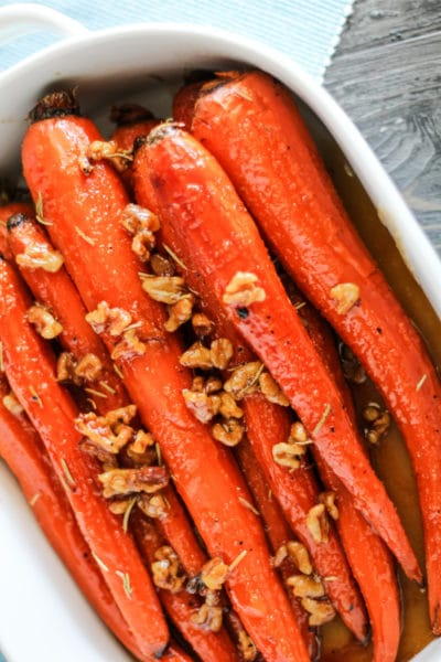 Honey and Maple Glazed i Carrots in a white serving dish.