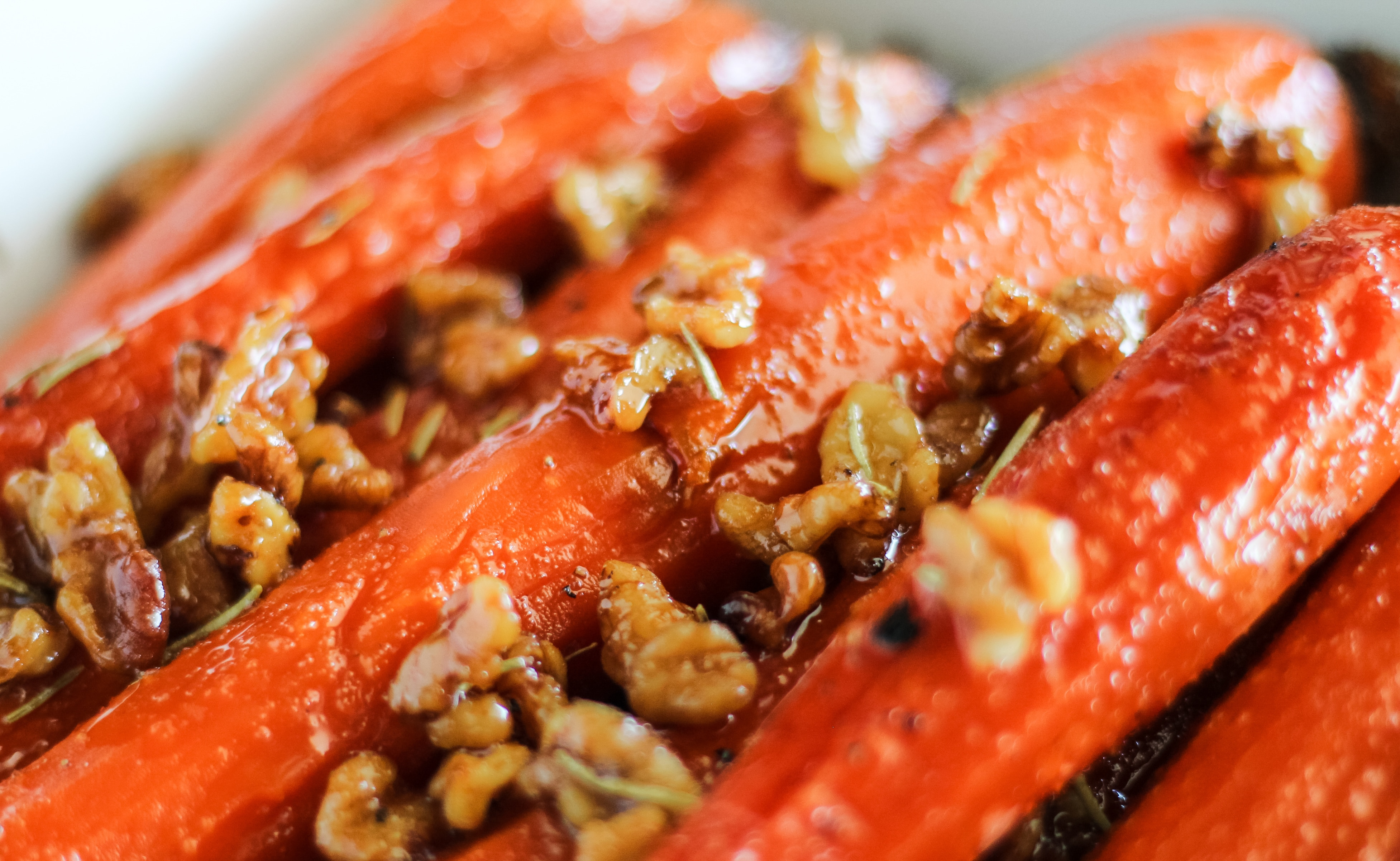 Honey and Maple Glazed Carrots garnished with walnuts and rosemary