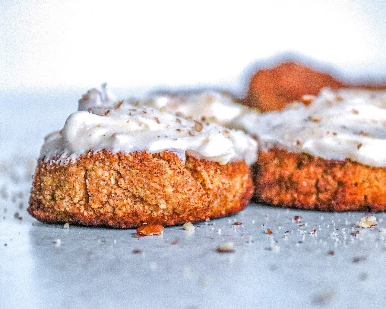 Two pumpkin snickerdoodles with cream cheese frosting