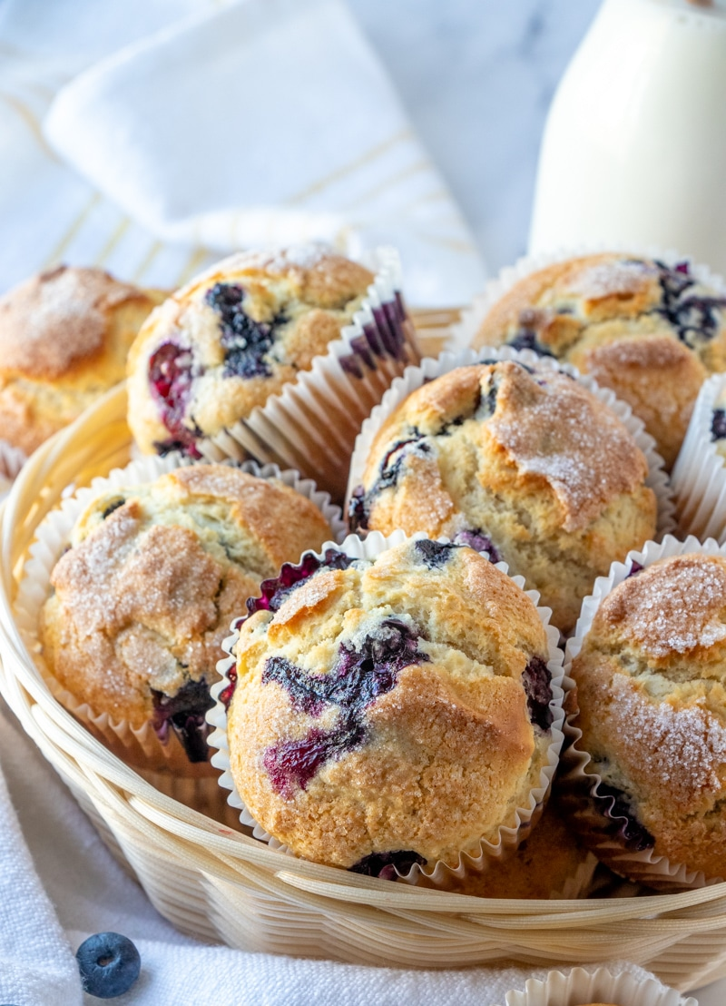 Blueberry muffins in a straw basket.