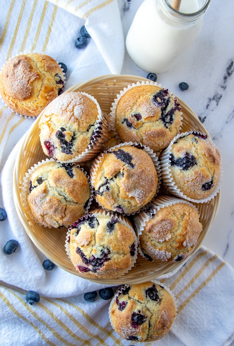 a basket full of blueberry muffins.