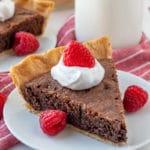 A single slice of Brownie Pie on a white plate