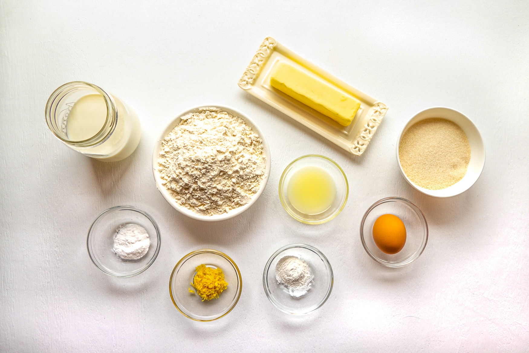 Ingredients needed to make cupcakes displayed on a white background.