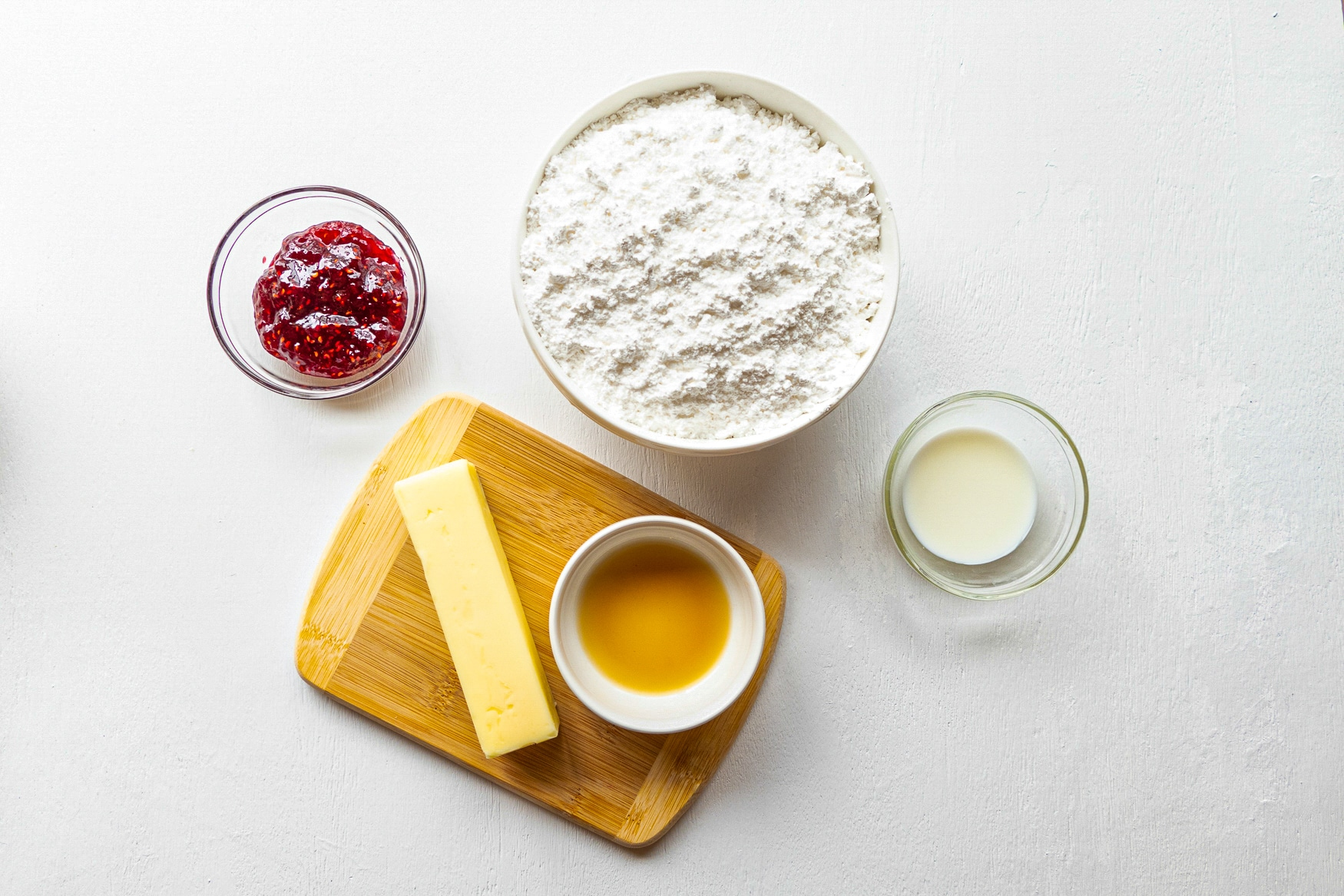 Ingredients needed to make buttercream frosting displayed on a white background.