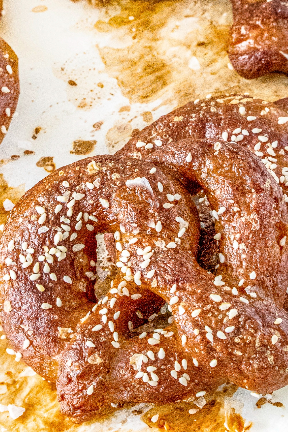 A Soft Beer Pretzel fresh from the oven garnished with salt and sesame seeds.
