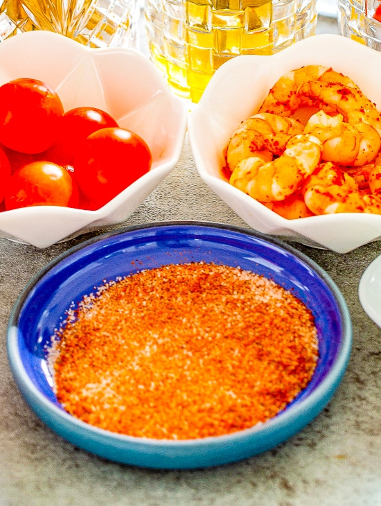 Paprika salt for the glass rim in a blue dish.