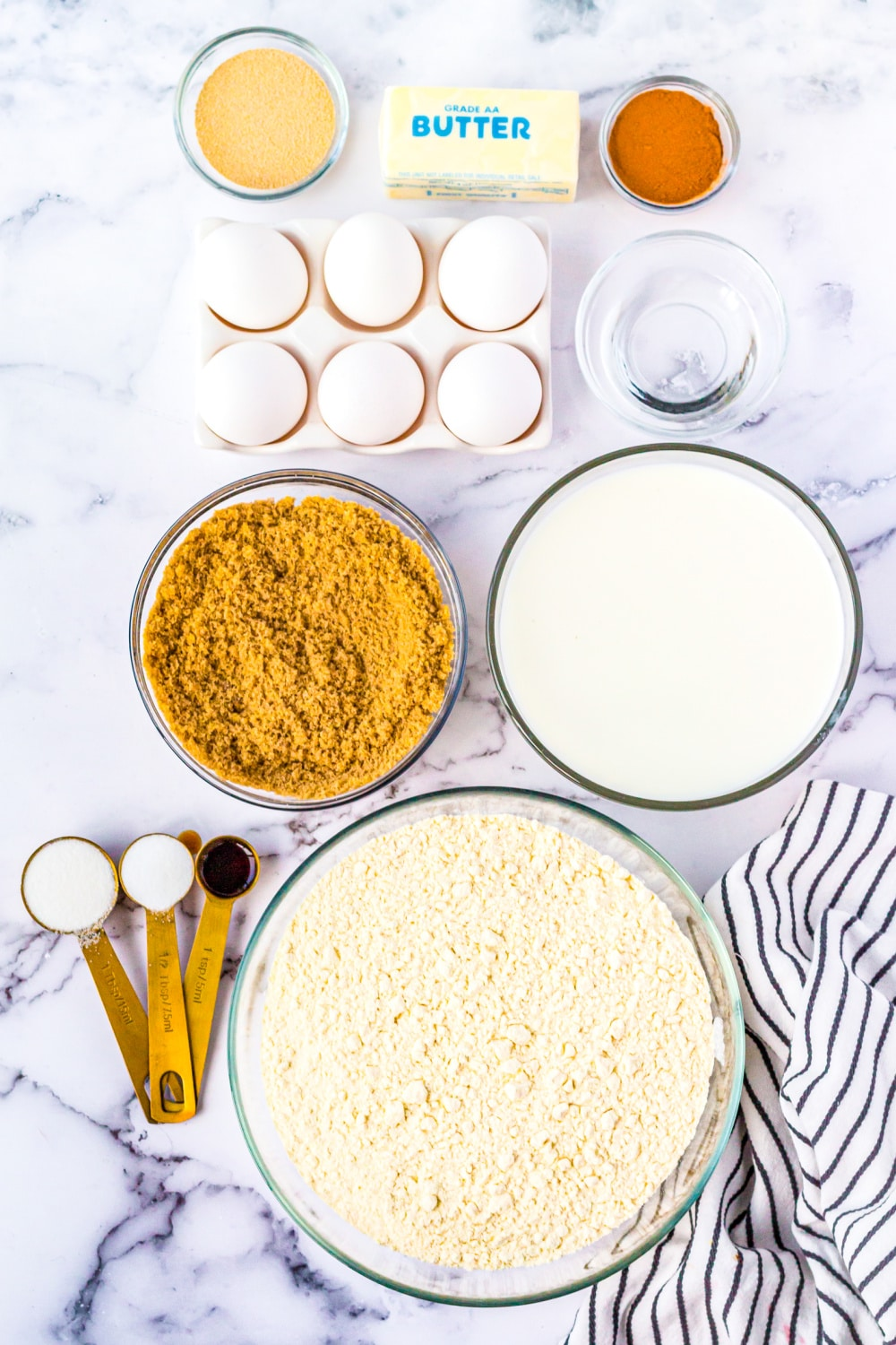 Ingredients needed to make this recipe separated in to clear bowls on a marble background.