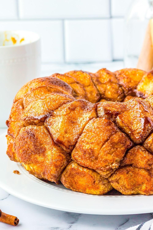 Homemade Monkey Bread on a white cake plate.